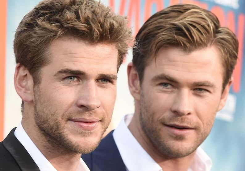 "Actors Liam Hemsworth (L) and Chris Hemsworth arrive for the premiere of Warner Bros' ""Vacation"""