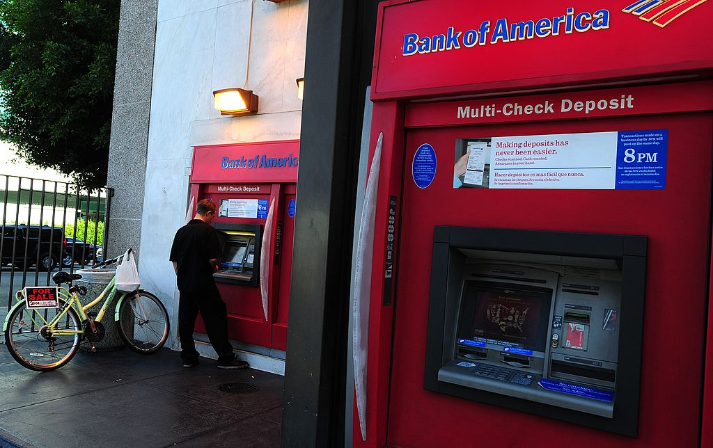 A man uses an automated teller machine at bank of america