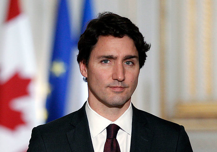 Canadian Prime minister, Justin Trudeau makes a statement during a press conference next to French President Francois Hollande at the Elysee Presidential Palace on November 29, 2015 in Paris, France. France will host climate change conference COP21 in Paris from November 30 to December 11, 2015.