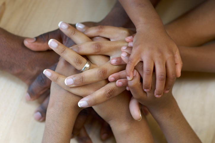 Family's hands together