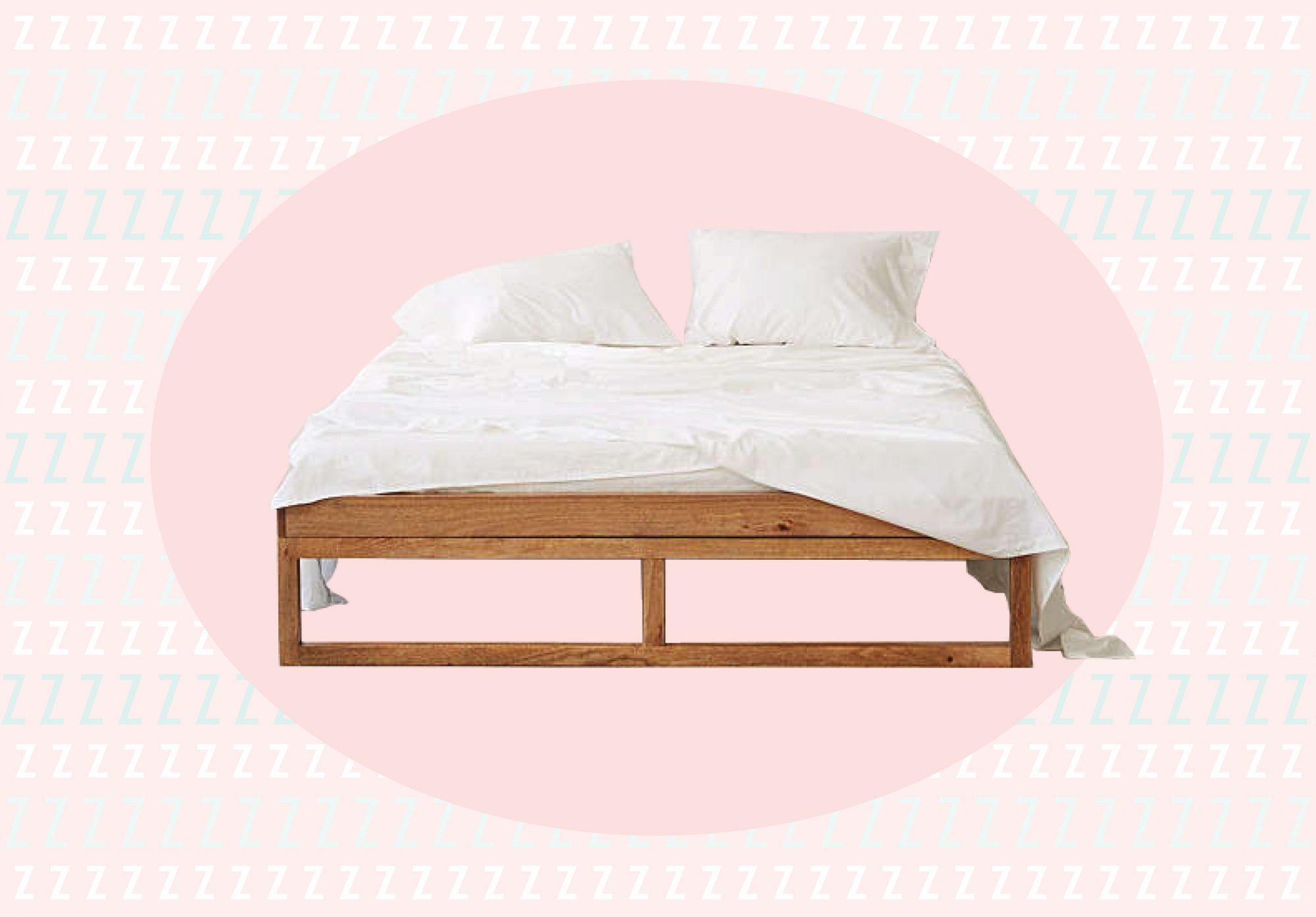 Platform bed against pink background.