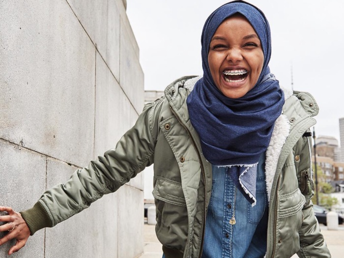 An American Eagle ad featuring model Halima Aden in a denim hijab