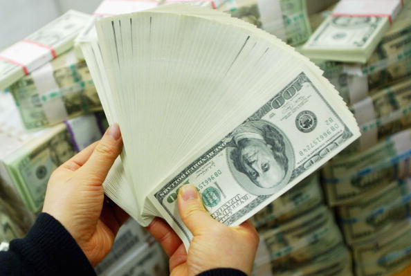 hands hold a pile of money