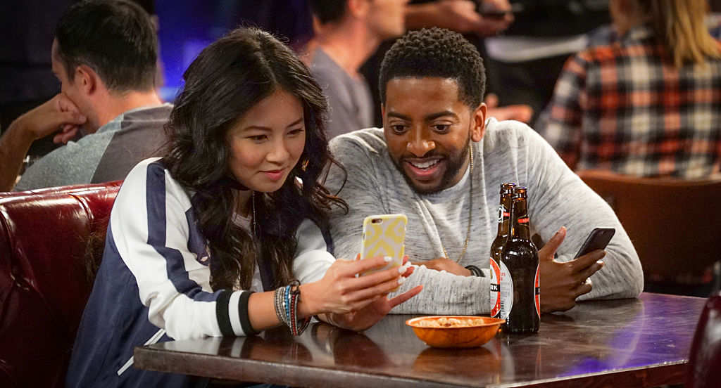 """LOS ANGELES - AUGUST 23: """"Dating Apps"""" -- Clark, Emma and Mason must intervene when Jack decides to try online dating and creates the worst profile ever for himself, on THE GREAT INDOORS, Thursday, Nov. 3 (8:31-9:01 PM, ET/PT) on the CBS Television Network. Pictured (L-R) Christine Ko as Emma and Shaun Brown as Mason (Photo by Monty Brinton/CBS via Getty Images)"""