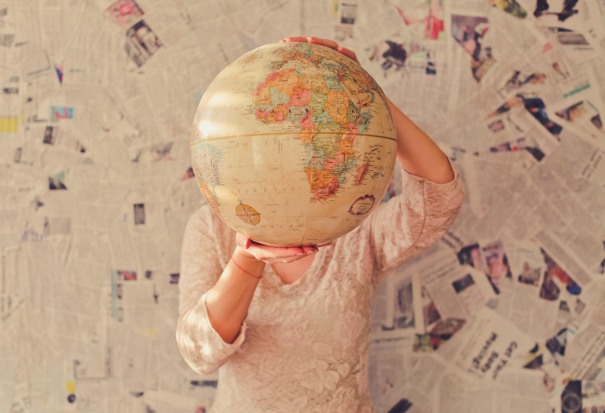 woman-holding-globe