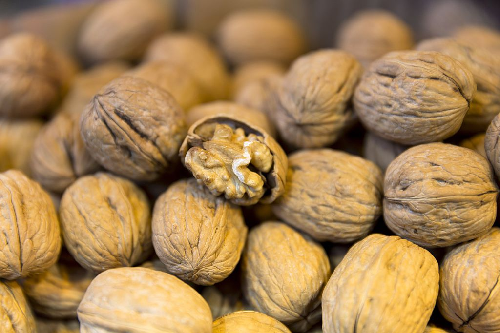 TURKEY - APRIL 03: Walnuts kernel in shells in the Misir Carsisi Egyptian Bazaar food and spice market in Istanbul, Turkey (Photo by Tim Graham/Getty Images)