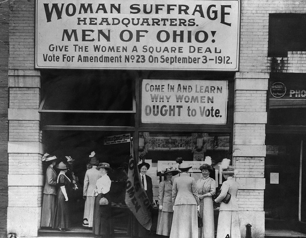 1912-Cleveland, OH: Photo of the Headquarters of women voters on upper Euclid Avenue in Cleveland. Holding the flag for suffagists is Miss Belle Sherwin, president of the organization.
