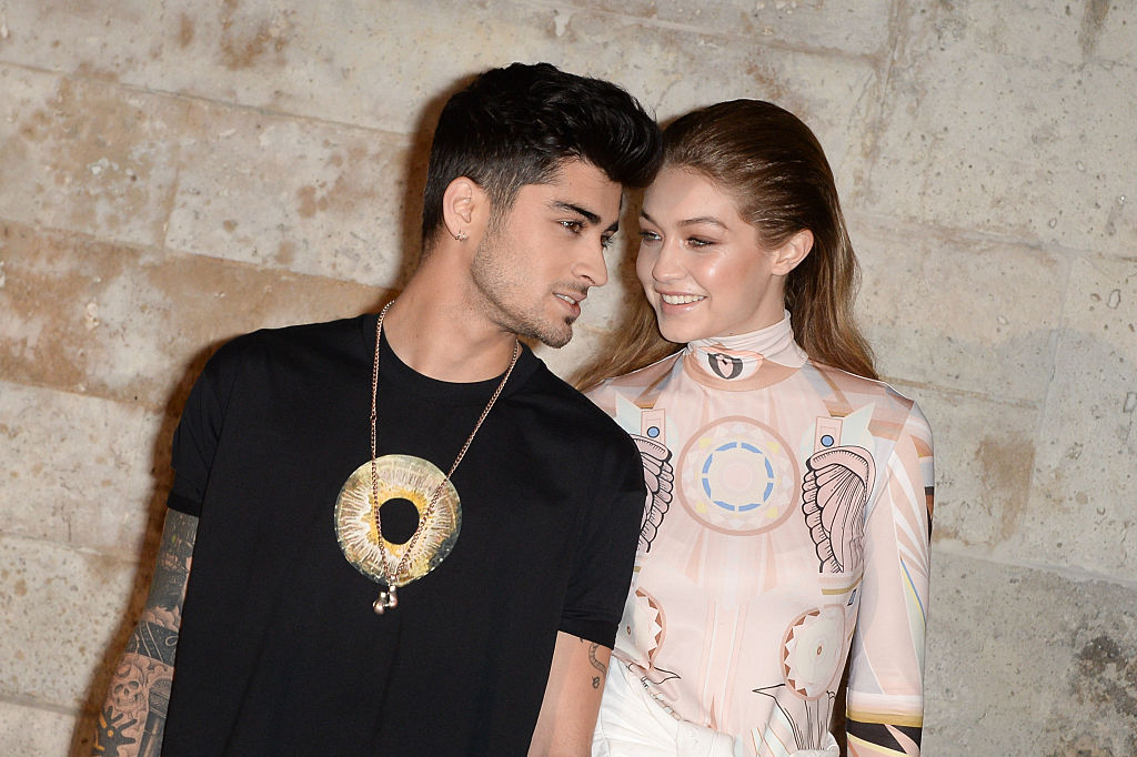 Zayn Malik and Gigi Hadid attend the Givenchy show as part of the Paris Fashion Week Womenswear Spring/Summer 2017on October 2, 2016 in Paris, France.