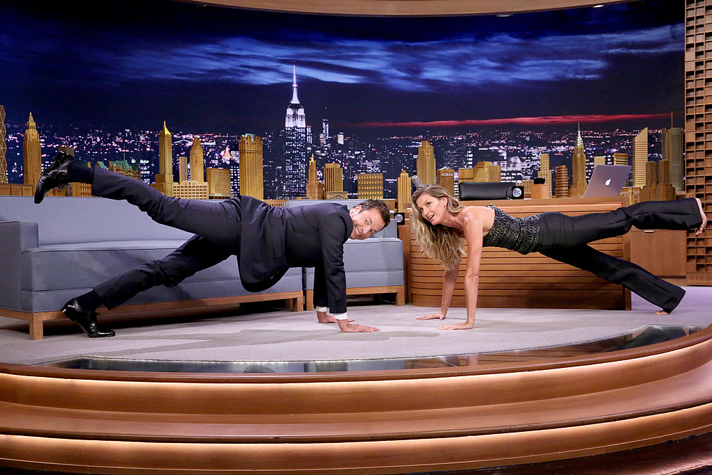 THE TONIGHT SHOW STARRING JIMMY FALLON -- Episode 0117 -- Pictured: (l-r) Host Jimmy Fallon and supermodel Gisele Bündchen practice yoga on September 4, 2014 -- (Photo by: Douglas Gorenstein/NBC/NBCU Photo Bank via Getty Images)