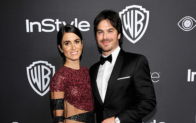 Ian Somerhalder and Nikki Reed pose on the red carpet