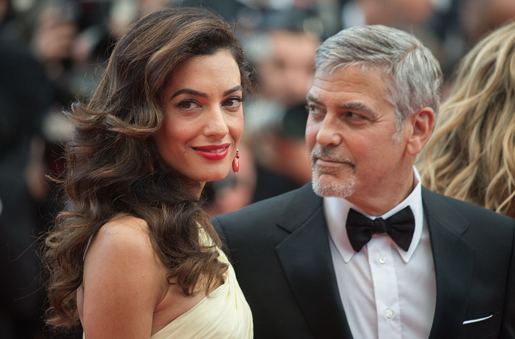 """CANNES, FRANCE - MAY 12: George Clooney and Amal Clooney attend the screening of """"Money Monster"""" at the annual 69th Cannes Film Festival at Palais des Festivals on May 12, 2016 in Cannes, France. (Photo by Samir Hussein/WireImage)"""