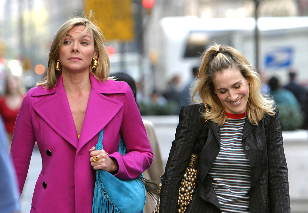 "Kim Cattrall and Sarah Jessica Parker during Kim Cattrall and Sarah Jessica Parker On Location For ""Sex And The City"" at Saks Fifth Ave in New York, New York, United States. (Photo by James Devaney/WireImage)"