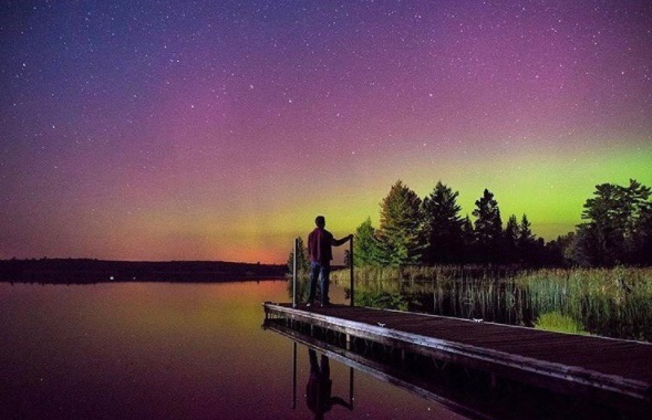 A man watches the Northern Lights in Minnesota