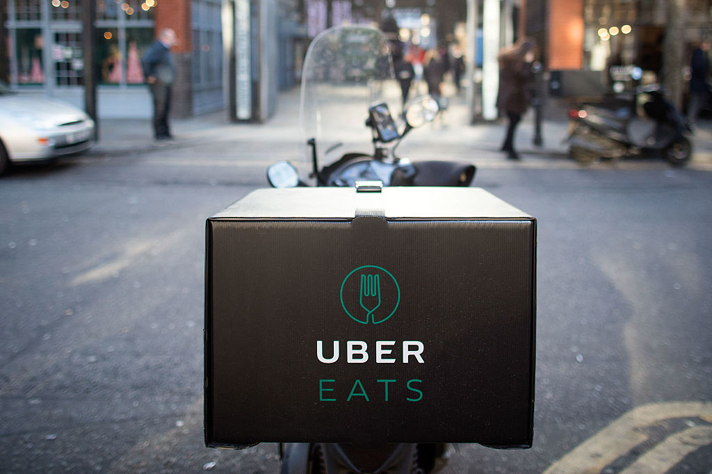An UberEats, operated by Uber Technologies Inc., branded box sits on a motor scooter in London, U.K., on Thursday, Dec. 22, 2016. The food delivery business model has proven attractive to venture capitalists, who last year poured $5.5 billion into food-delivery companies globally, according to research firm CB Insights. Photographer