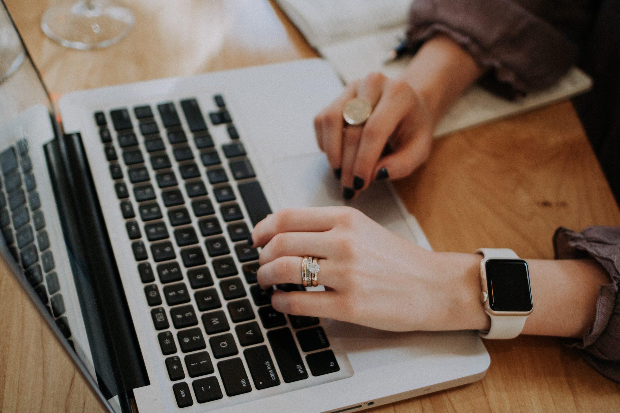 woman-typing-on-laptop-keyboard