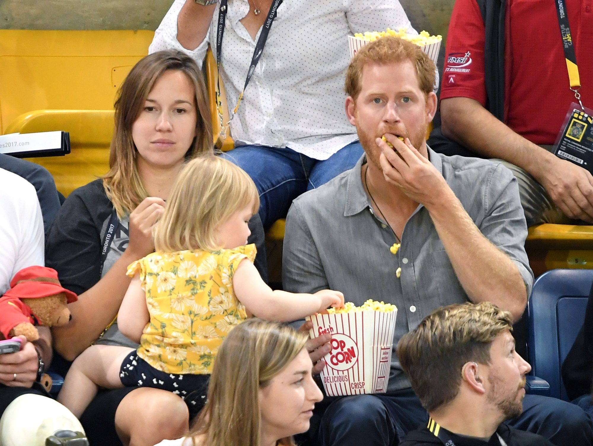 Image of Prince Harry with popcorn-stealing toddler