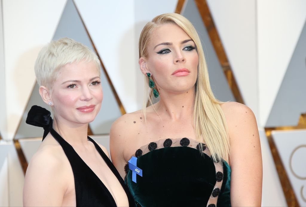 Michelle Williams (L) and Busy Philipps arrive at the 89th Annual Academy Awards at Hollywood & Highland Center on February 26, 2017 in Hollywood, California.