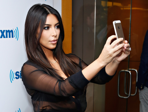 Kim Kardashian takes a selfie at the SiriusXM Studios on August 11, 2014 in New York City.