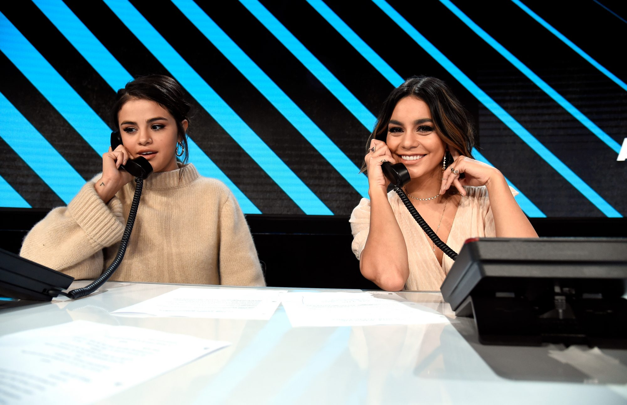 LOS ANGELES, CA - OCTOBER 14:  In this handout photo provided by One Voice: Somos Live!, Selena Gomez and Vanessa Hudgens participate in the phone bank onstage during