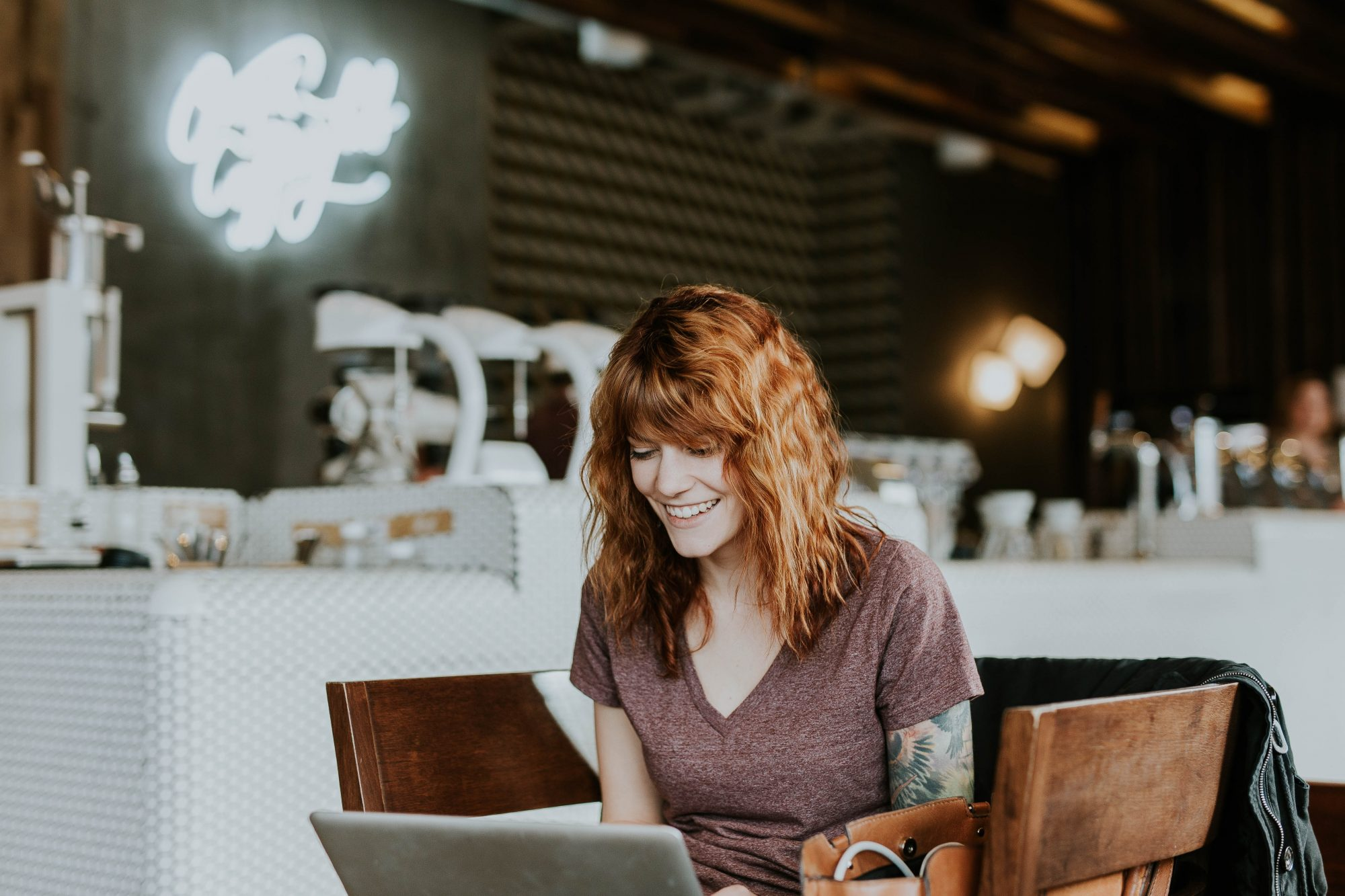woman-with-red-hair-working-on-laptop