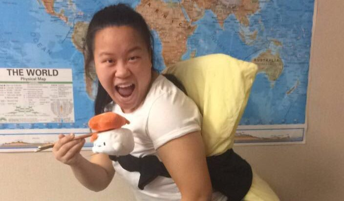 A high school student dressed up as sushi