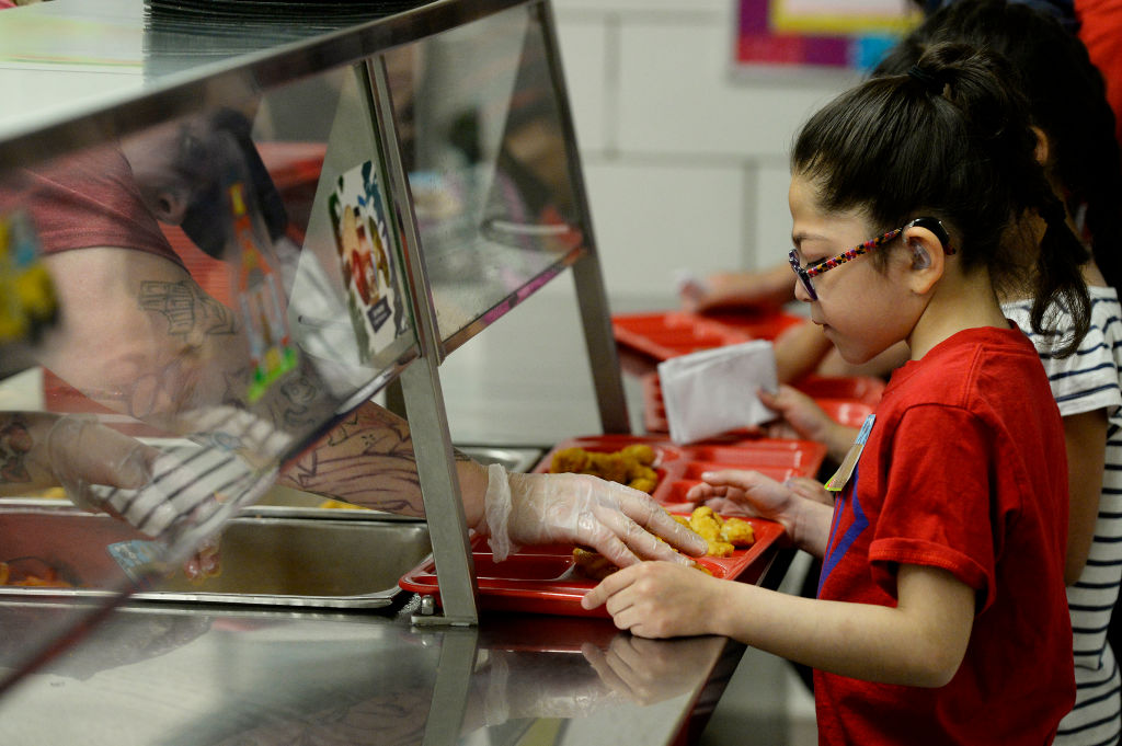 THORNTON, CO - JUNE 5: Valeria Contreras, 6, gets a handful of fries on her tray during lunch at North Star Elementary School on June 5, 2017, in Thornton, Colorado. Adams 12 Five Star Schools offers free breakfast and/or lunch this summer at six schools to children ages one to 18 years old along with a day program at select sites. (Photo by Seth McConnell/The Denver Post via Getty Images)