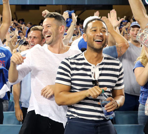 LOS ANGELES, CA - OCTOBER 25: Actor George Lopez, jeweler Ben Baller, photographer Mike Rosenthal and musician John Legend celebrate a Dodgers homerun during The 2017 World Series - Game 2 at Dodger Stadium on October 25, 2017 in Los Angeles, California