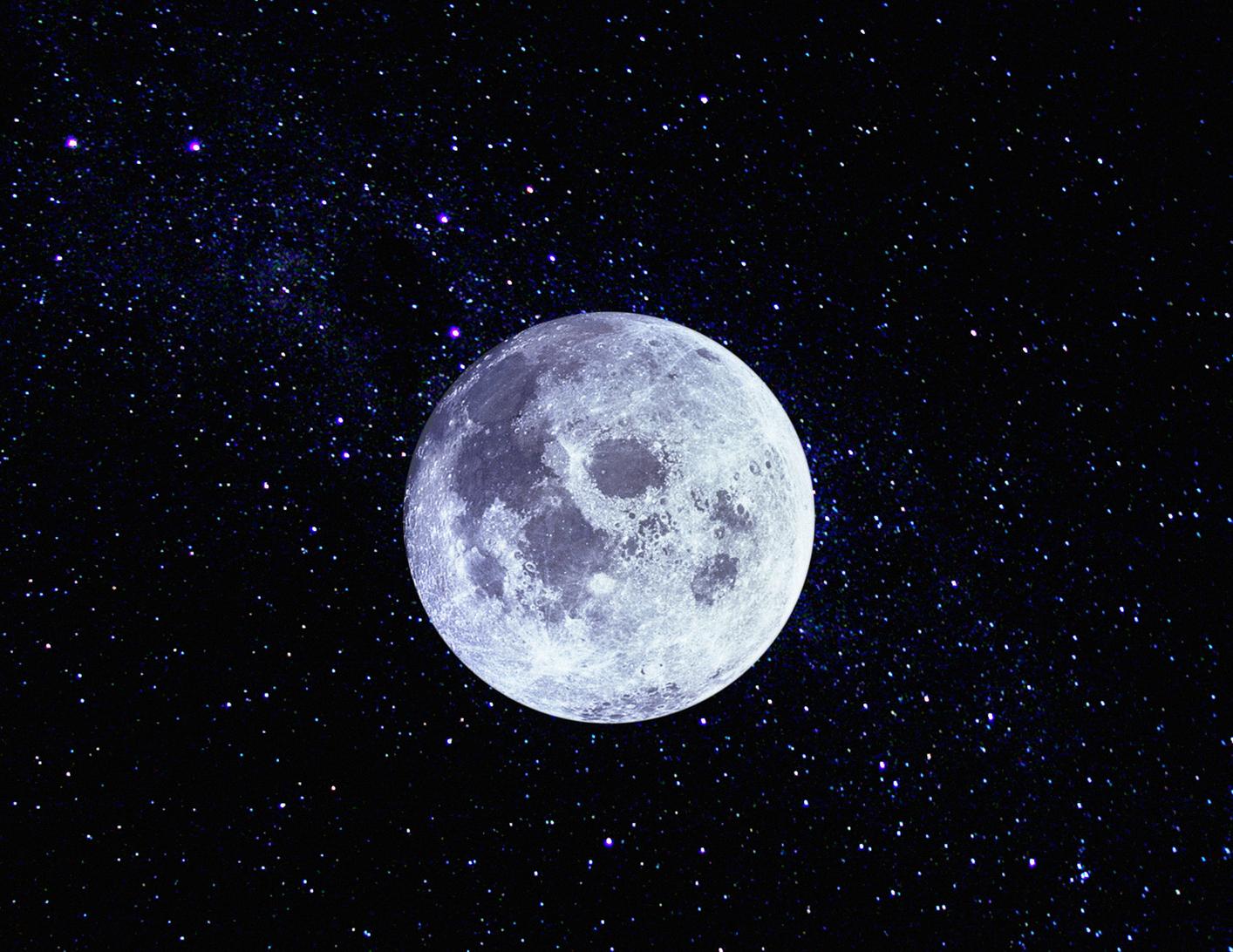 Full moon reflecting on ocean at night