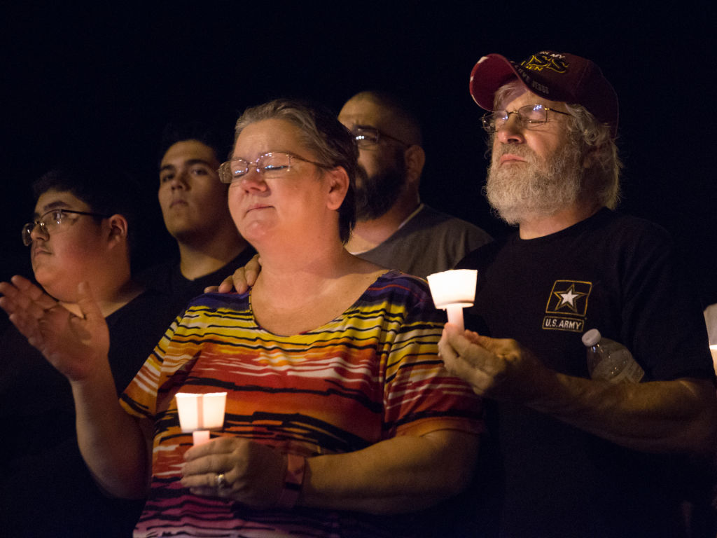 A candlelight vigil is observed on November 5, 2017, following the mass shooting at the First Baptist Church in Sutherland Springs, Texas, that left 26 people dead according to authorities. / AFP PHOTO / SUZANNE CORDEIRO (Photo credit should read SUZANNE CORDEIRO/AFP/Getty Images)