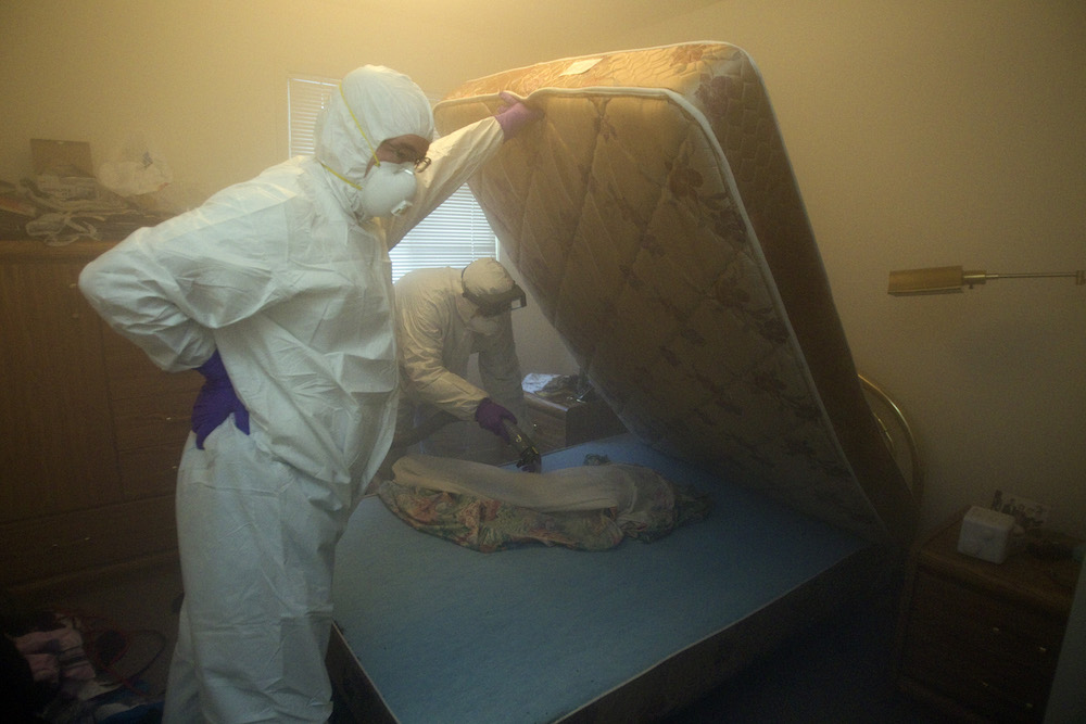 January 10, 2011 Christian Cadieux (R), owner of Bed Bugs Bite , and employee Jeff Lake deodorizes a matress as part of their process to get rid of bedbugs.