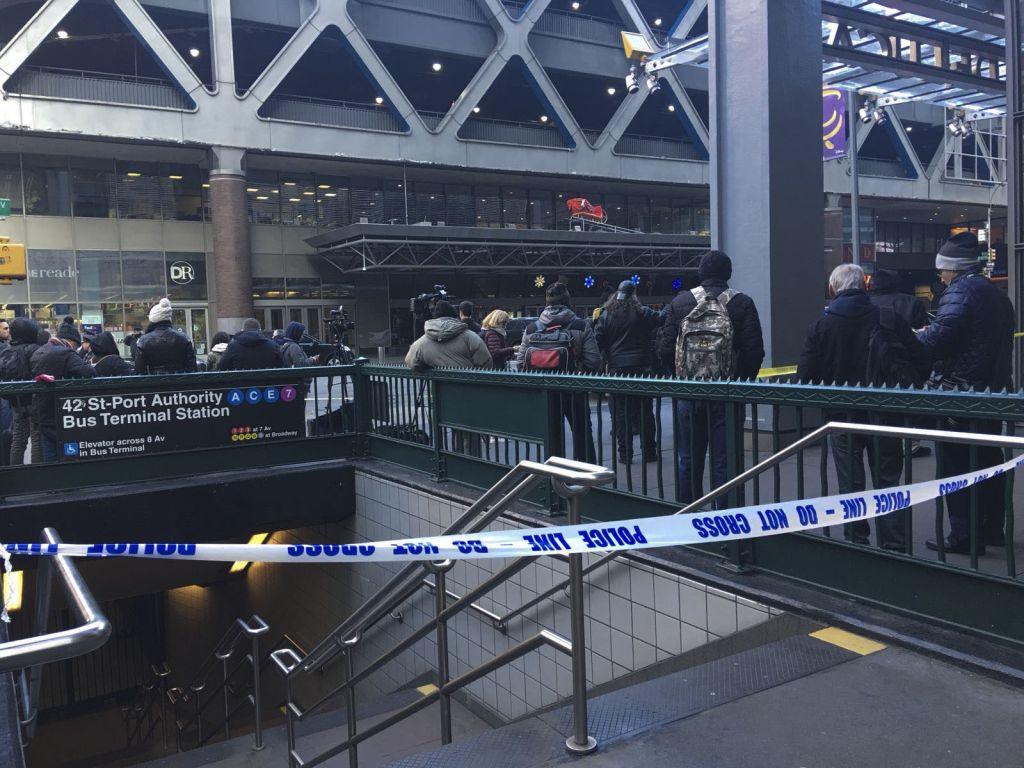 """NEW YORK, USA - DECEMBER 11 : Entrance of the 42 St-Port Authority Bus Terminal Station is seen blocked with """"Do Not Cross"""" tapes after an explosion occured in New York, United States on December 11, 2017. (Photo by Ertugrul Cingil/Anadolu Agency/Getty Images)"""