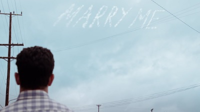 schmidt-marry-me-cece-skywriting.jpg