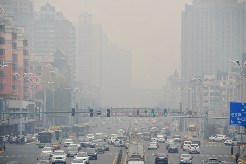 A view of the XianFeng Street of Harbin, China, with a heavy smog of pollution over the city on October 11, 2017.