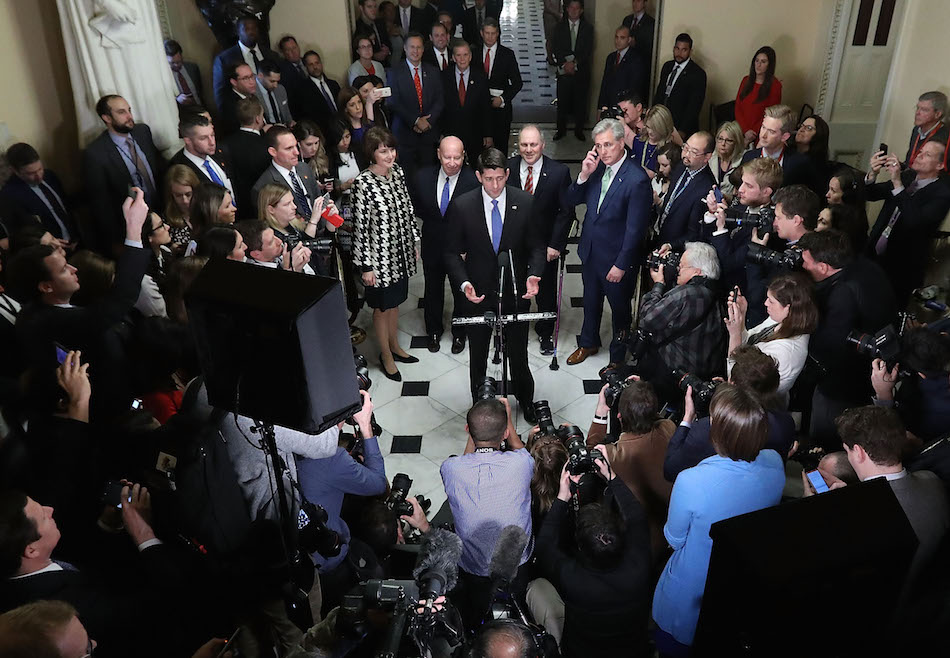 Speaker of the House Paul Ryan is joined by House Republican leaders while talking to reporters following passage of the Tax Cuts and Jobs Act