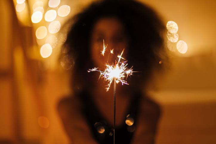 Girl holds Christmas sparkles