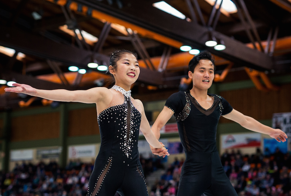 North Korean figure skaters Ryom Tae Ok and Kim Ju Sik react after competing in the Pairs Free Skating during the 2017 Nebelhorn Trophy competition.
