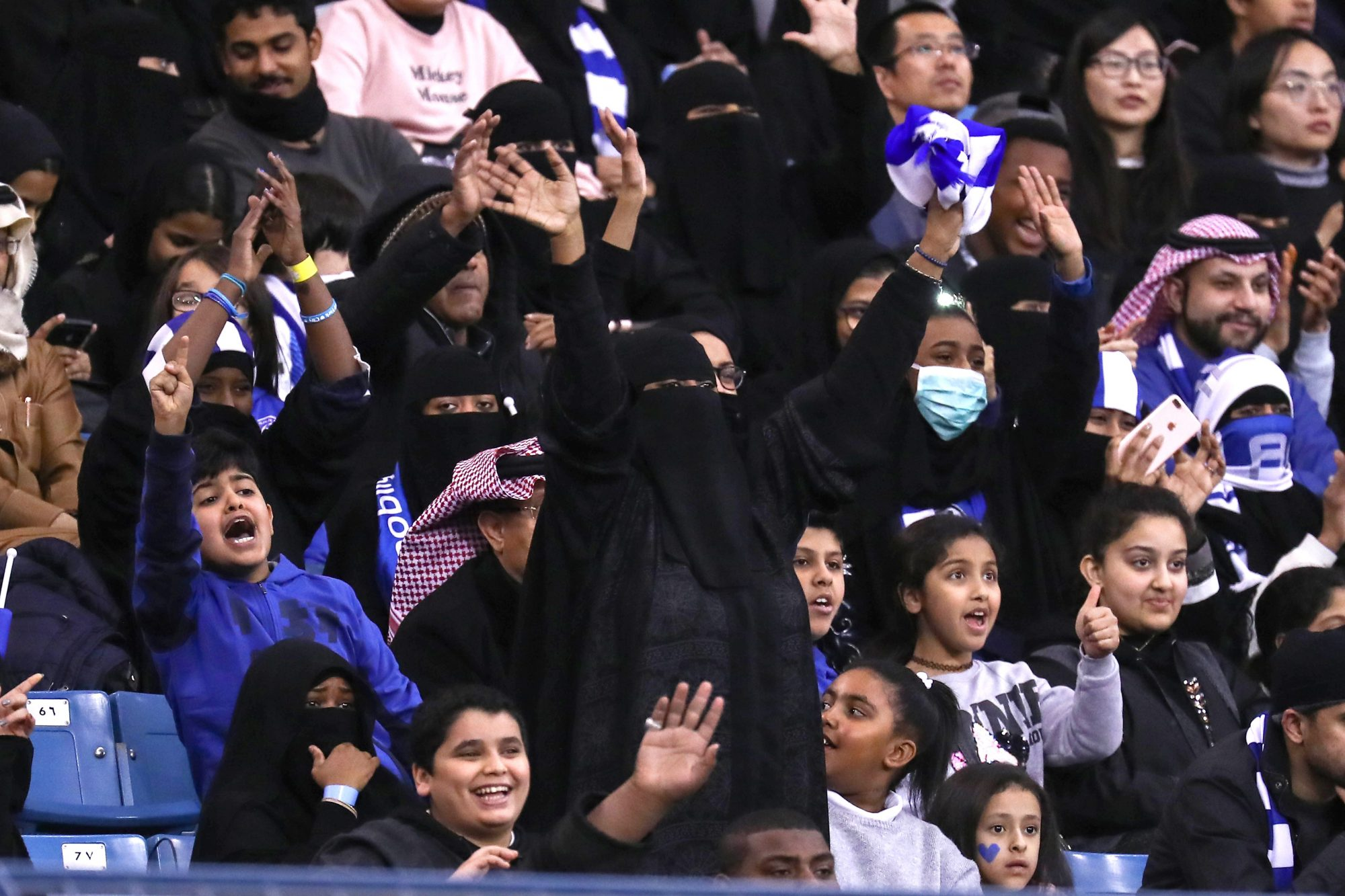 Photo of Female Supporters Cheering at a Saudi Arabian soccer match