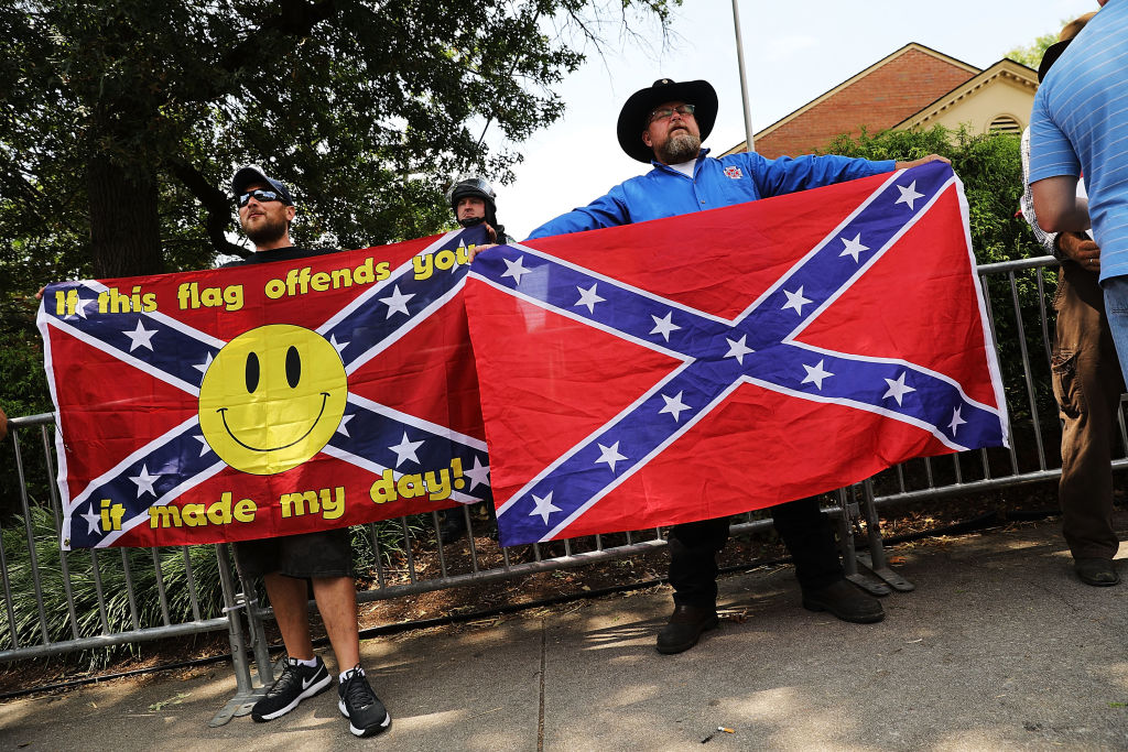KNOXVILLE, TN - AUGUST 26: A small number of pro-confederate supporters face off against hundreds of demonstrators against a Confederate memorial monument in Fort Sanders as stand against the removal of the on August 26, 2017 in Knoxville, Tennessee. The rally around the disputed memorial to the Civil War dead comes two weeks after a gathering of white supremacists and counter demonstrators in Charlottesville, Virginia that turned deadly. (Photo by Spencer Platt/Getty Images)
