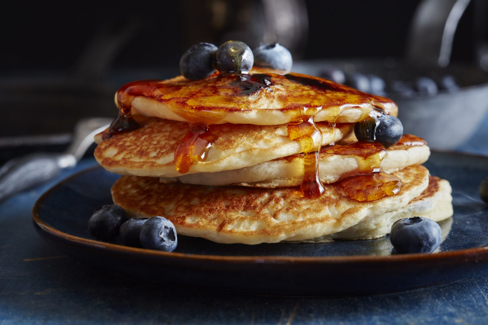Photo of Blueberry Pancakes With Fresh Berries and Syrup