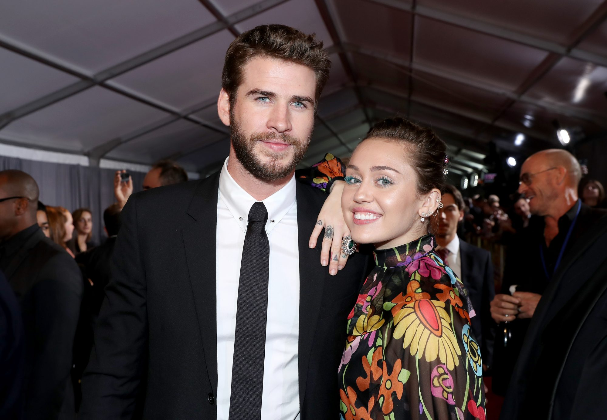 Photo of Miley Cyrus and Liam Hemsworth