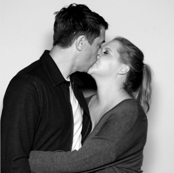 Amy Schumer and Chris Fischer kissing