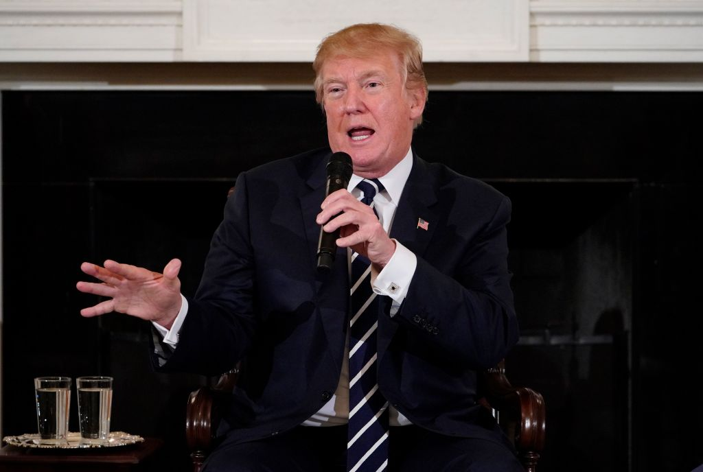 rump floated the idea of arming teachers and promised more stringent background checks on gun owners as he hosted an emotional meeting Wednesday with students who survived last week's mass shooting at a Florida school. / AFP PHOTO / MANDEL NGAN (Photo credit should read MANDEL NGAN/AFP/Getty Images)