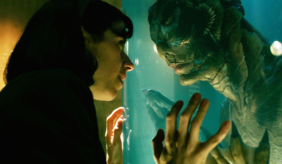 """Sally Hawkins touches the tank of the Amphibian Man in """"The Shape Of Water"""""""