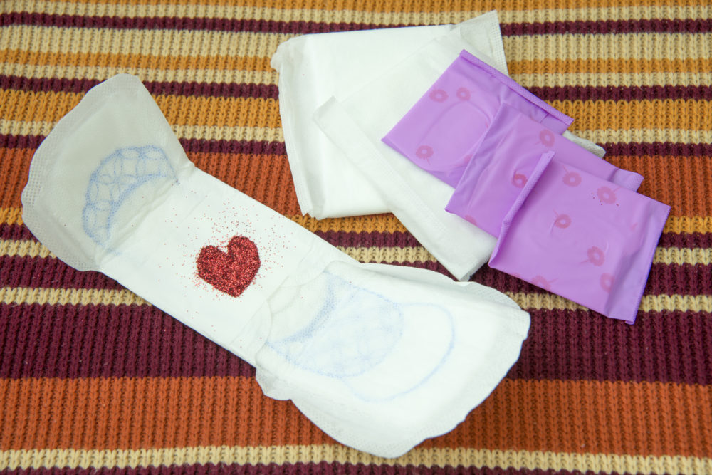 Image of sanitary napkin with glitter heart