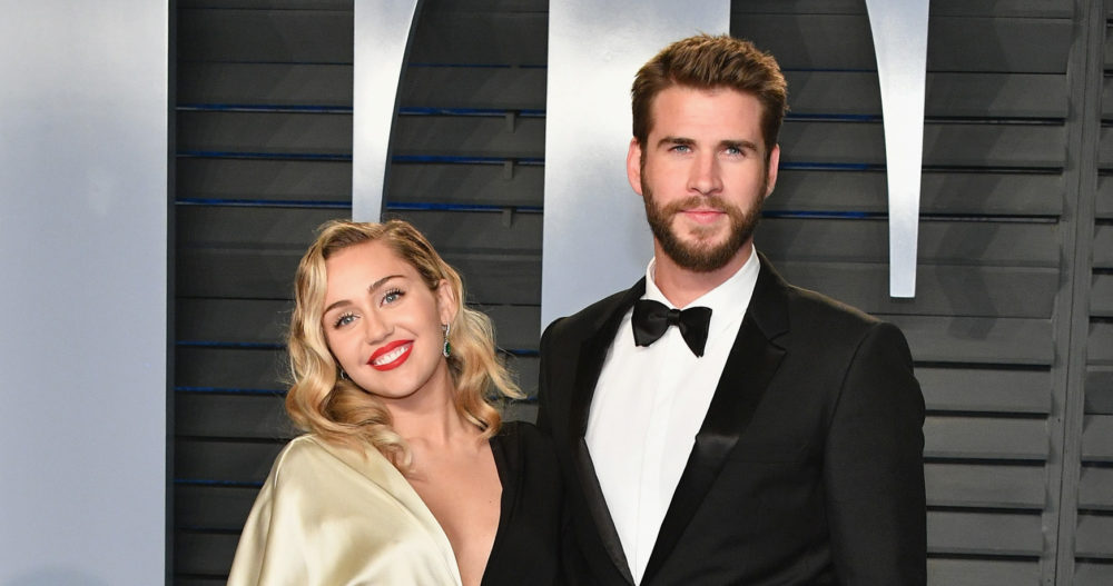 BEVERLY HILLS, CA - MARCH 04: Miley Cyrus (L) and Liam Hemsworth attend the 2018 Vanity Fair Oscar Party hosted by Radhika Jones at Wallis Annenberg Center for the Performing Arts on March 4, 2018 in Beverly Hills, California.