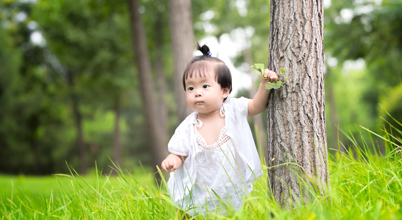 A baby girl in nature