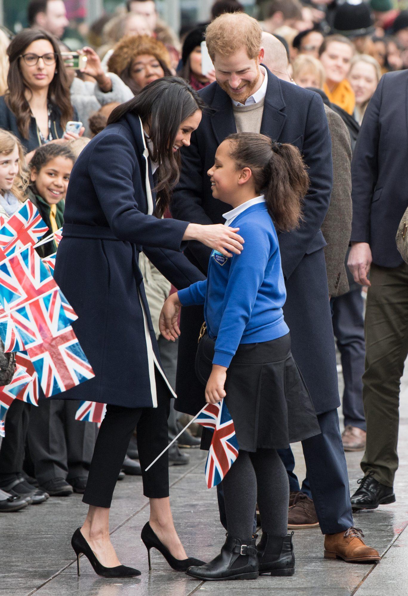 meghan-markle-hugs-schoolgirl-royal-engagement.jpg