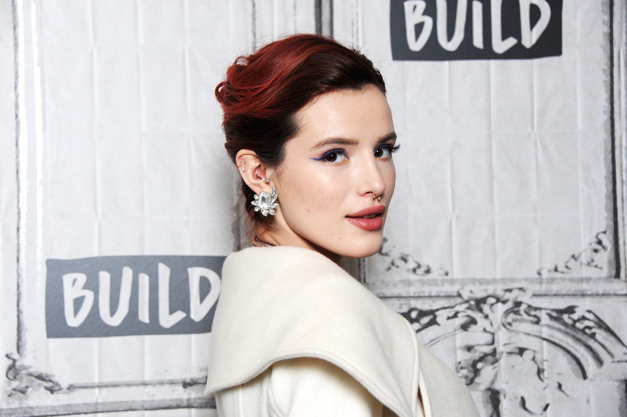 Bella-Thorne-white-coat.jpg