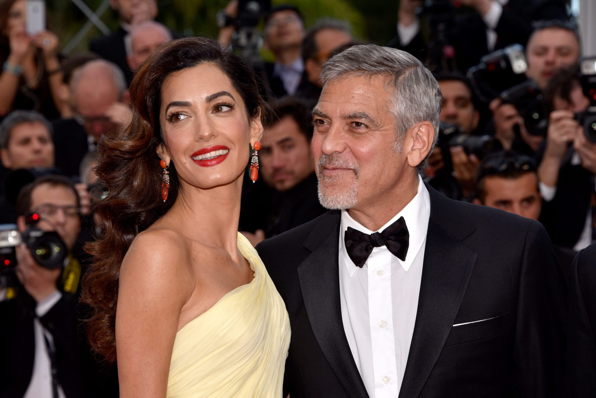 Photo of March For Our Lives Attendees George and Amal Clooney
