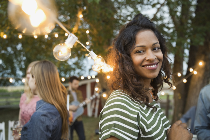 Portrait of smiling woman at outdoor party